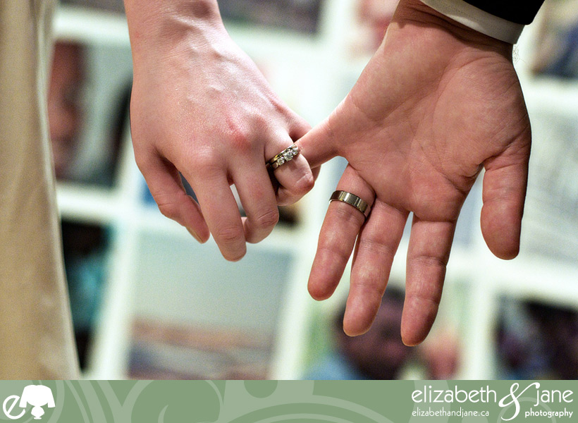 Wedding rings holding hands