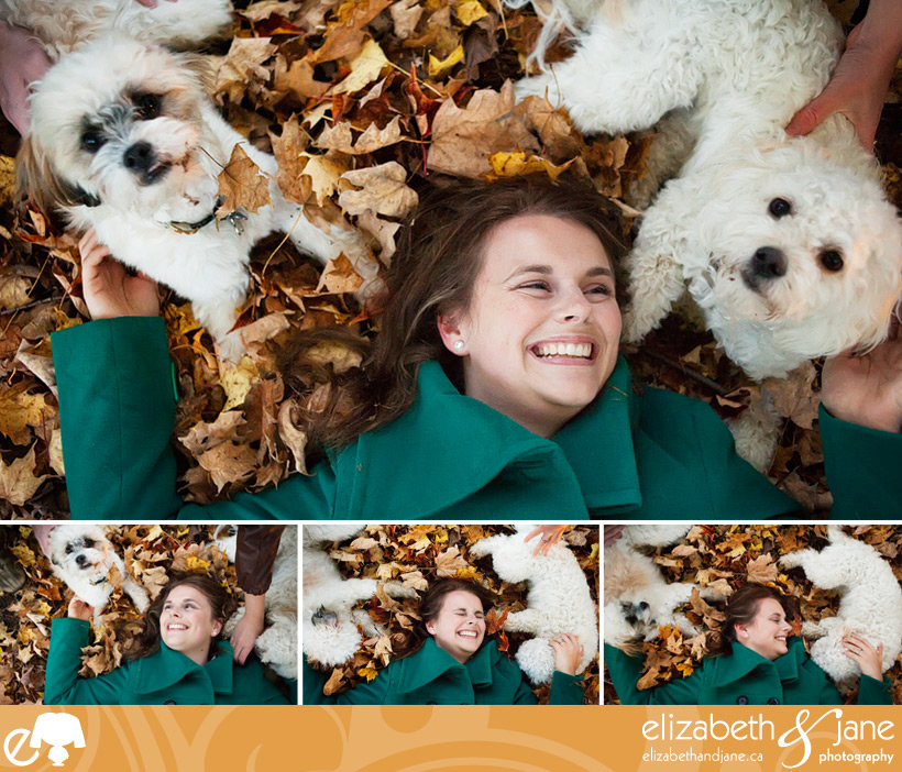 Dog photo: woman cuddling with two dogs in the leaves