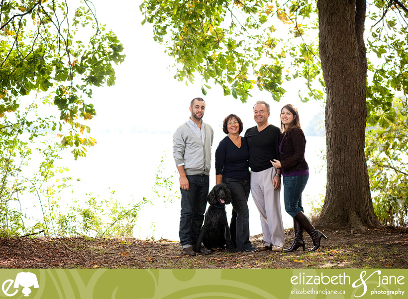 Family Photography: family standing under a tree