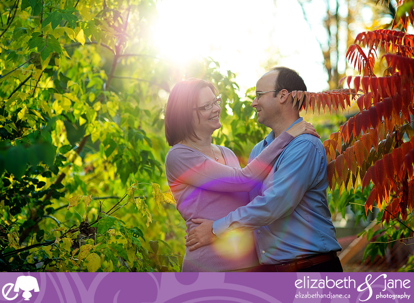 Engagement Photo: couple standing in the sun