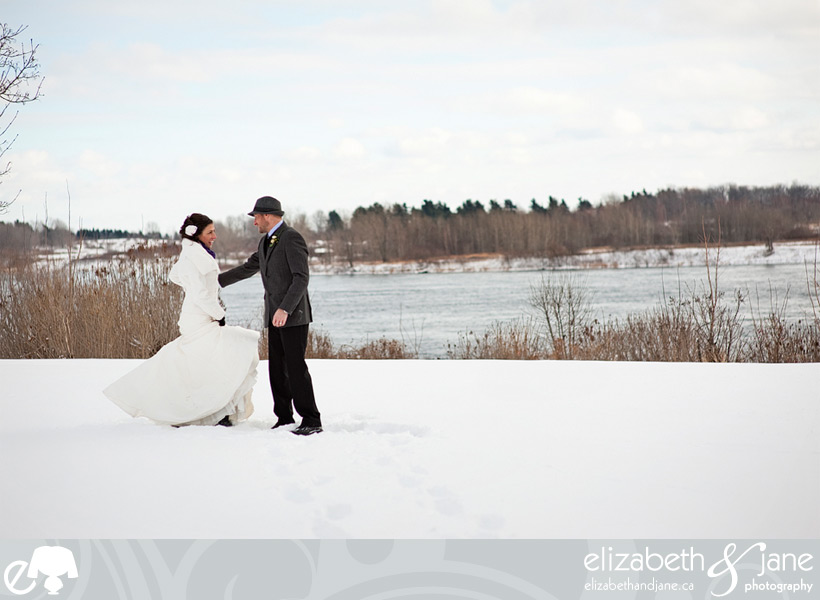 Wedding Photo: bride and groom dancing in the snow