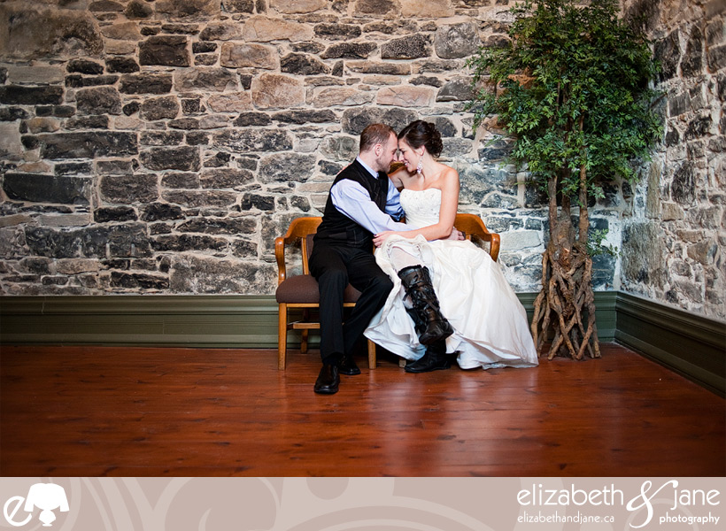 Wedding Photo: bride and groom cuddling indoors