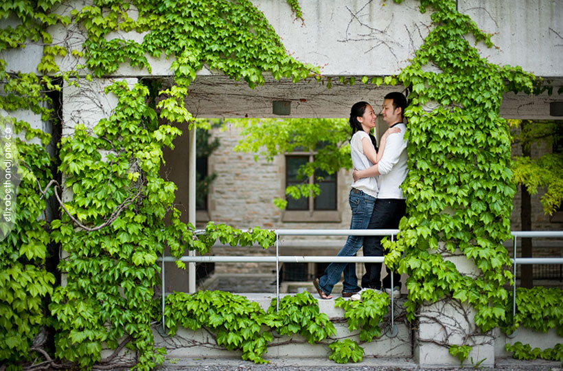Ottawa engagement and wedding: couple standing amongst vines at the National Art Gallery in Ottawa