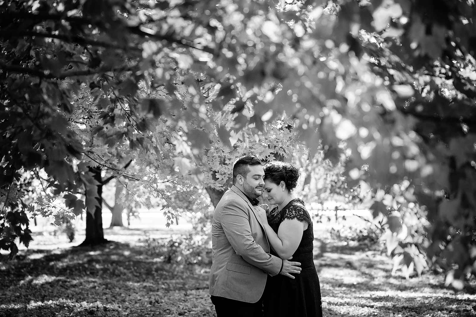 Carina and Alex's Engagement session in Ottawa at the Arboretum Central Experimental Farm with the couple cuddling through the trees