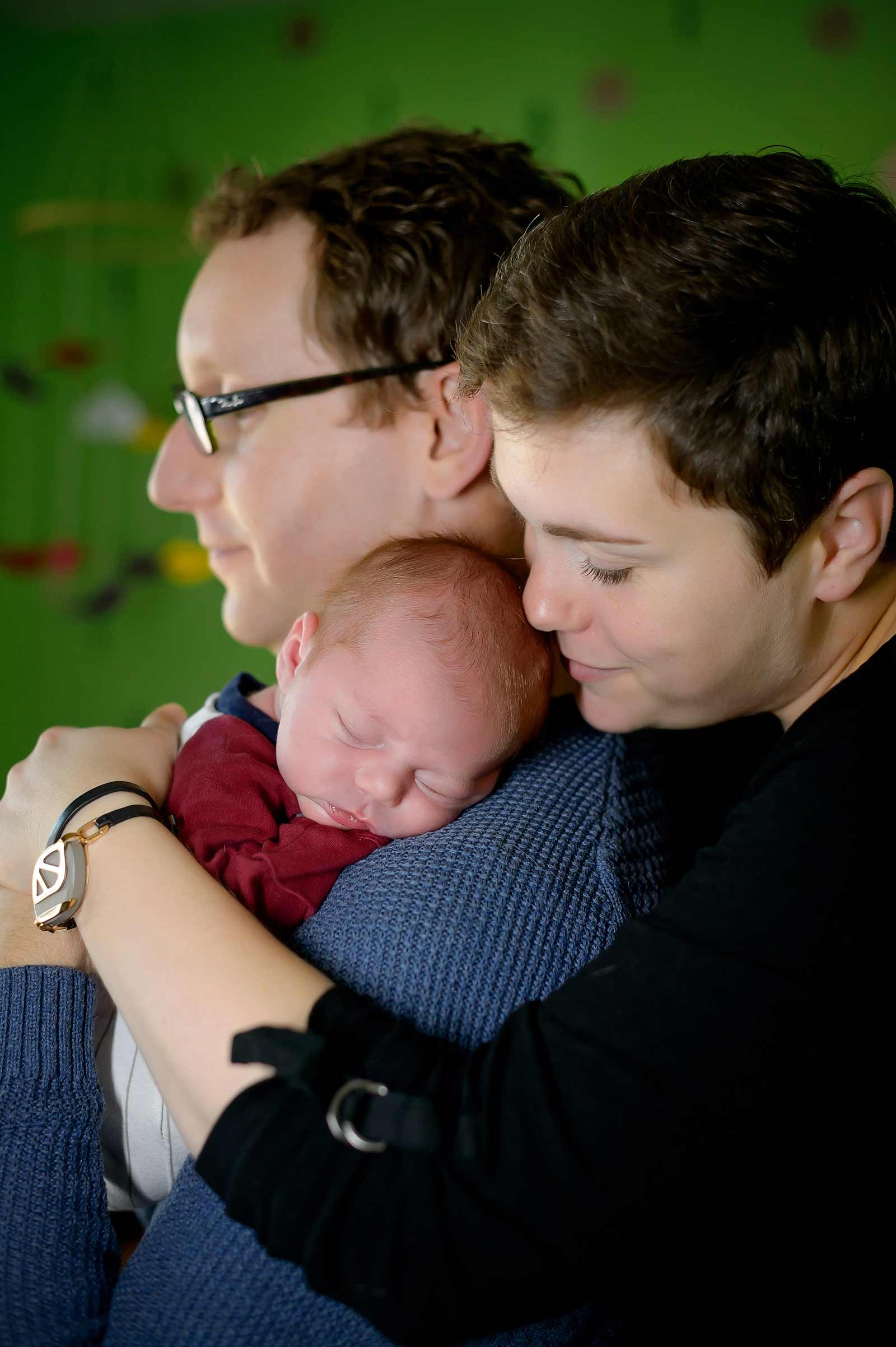 Chester sleeping on his Dad while is Mom cuddled him in Ottawa at his baby session.