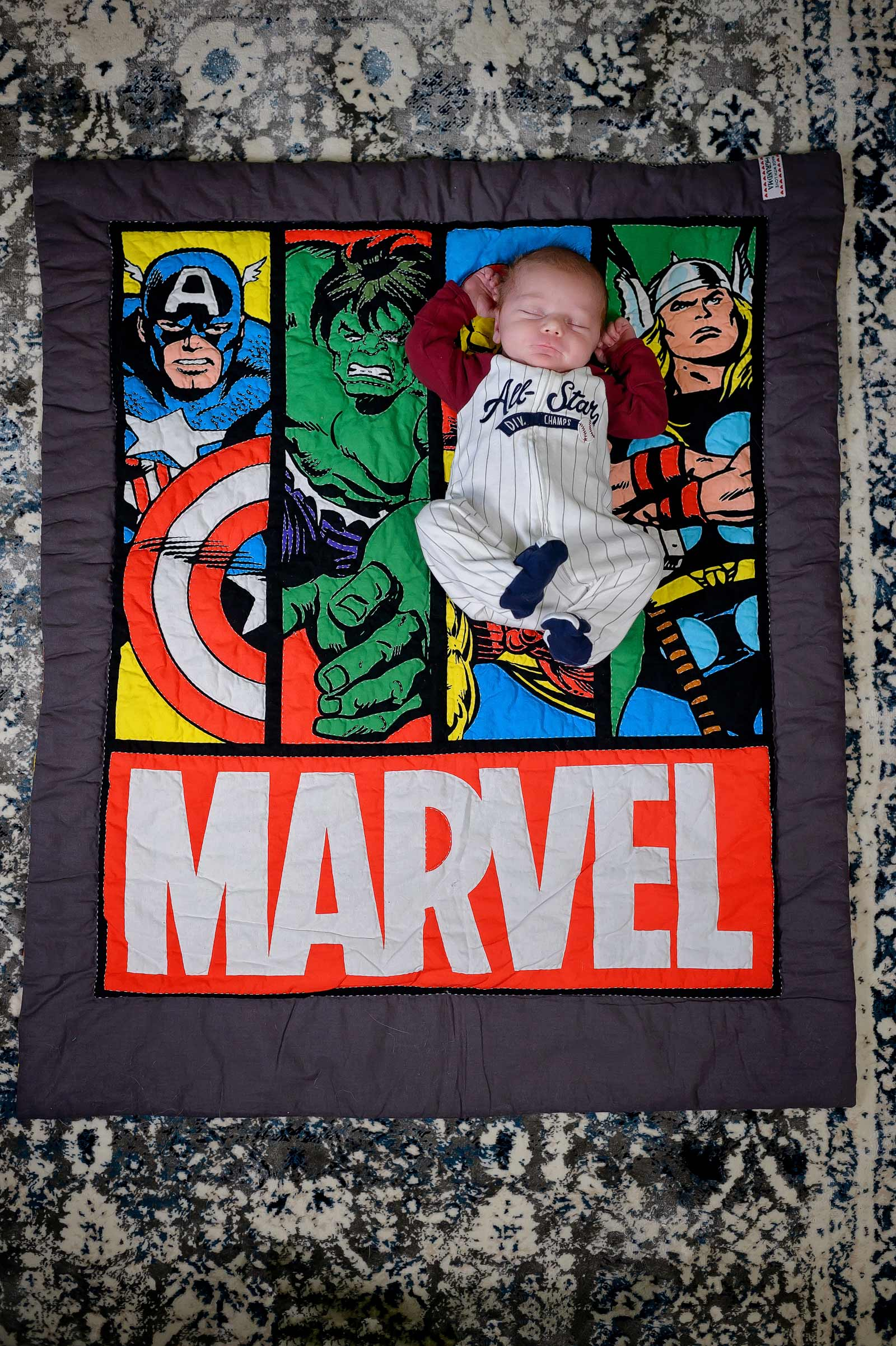 Ottawa baby photographer asleep on a nerdy and geeky Marvel blanket
