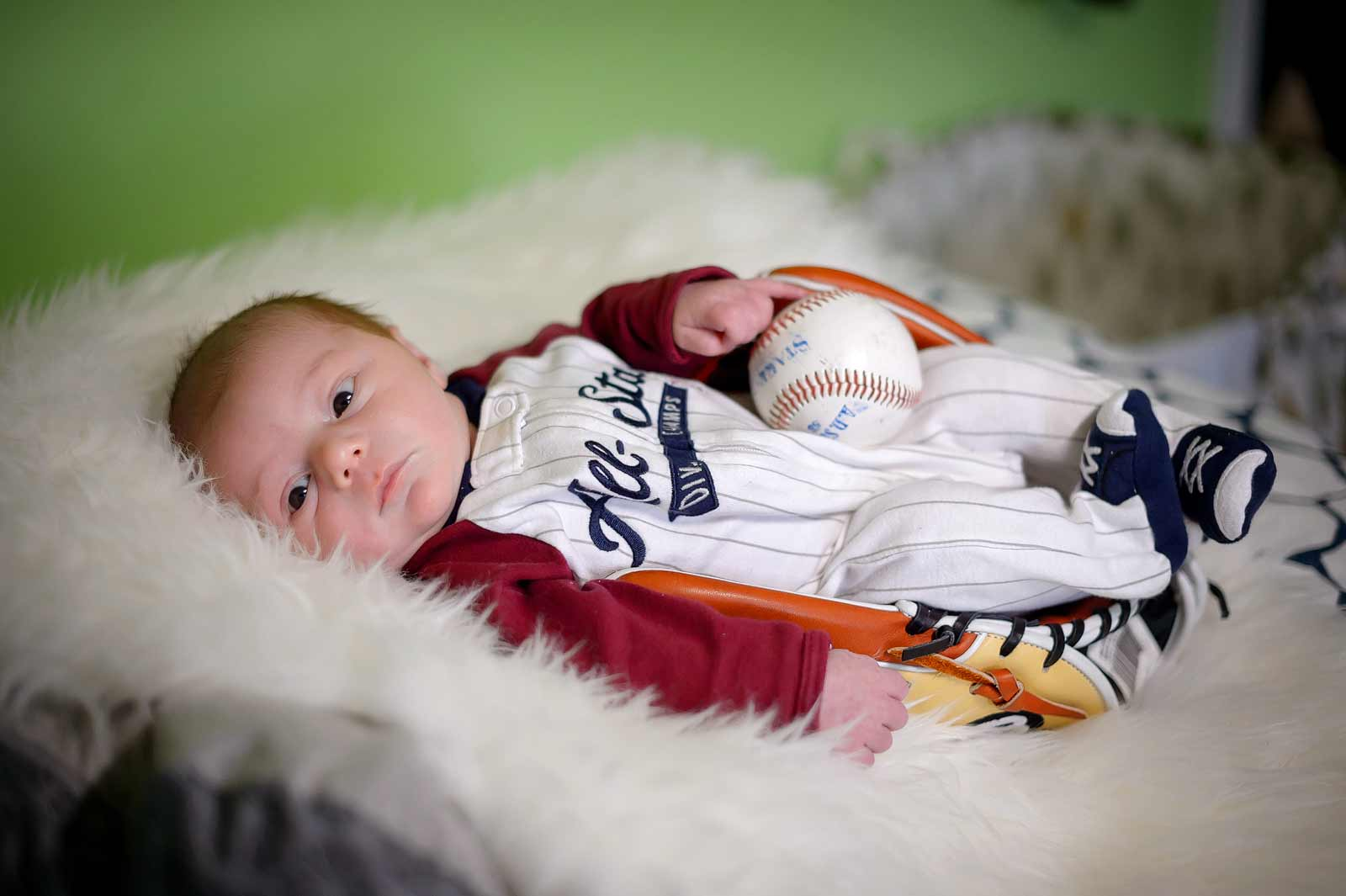 Ottawa baby photographer newborn in baseball met with baseball