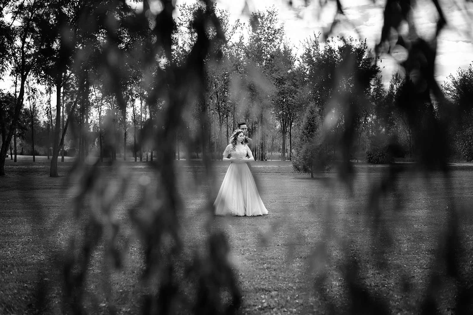 Kayla and Eli's Ottawa Wedding Photography at Stonefields in Carleton Place, Beckwith, Ontario with the bride and groom standing together in black and white