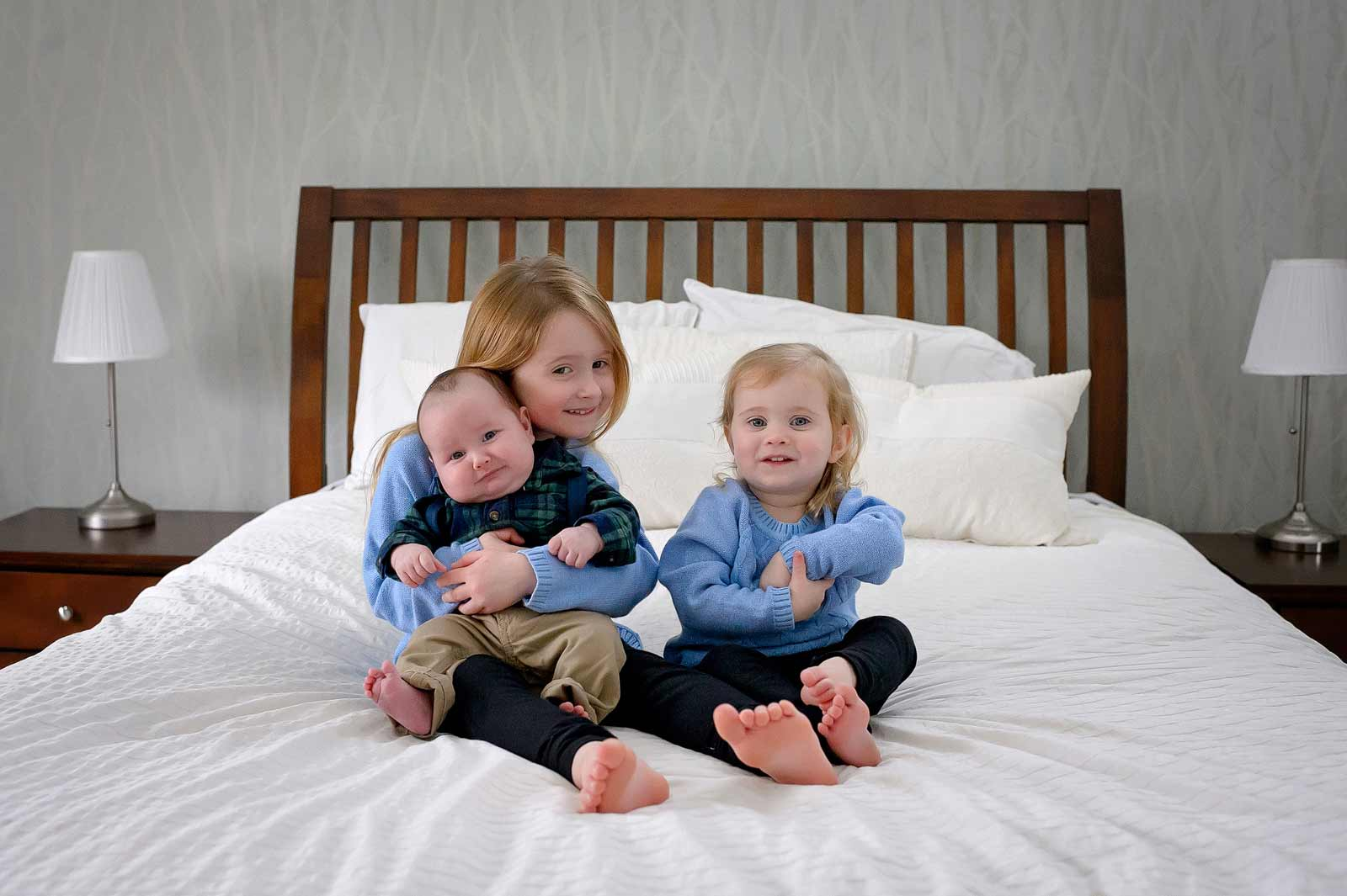 Baby Connor being hugged and cuddled with his siblings in Ottawa, Ontario