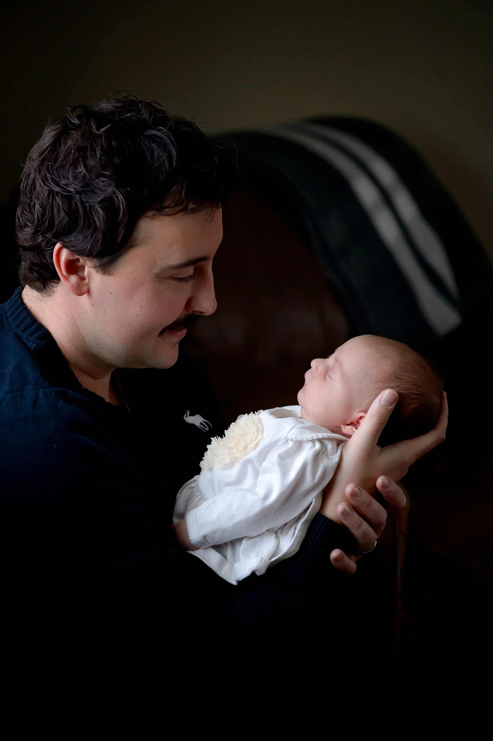 Baby Maeve being held by her Dad in Ottawa, Ontario