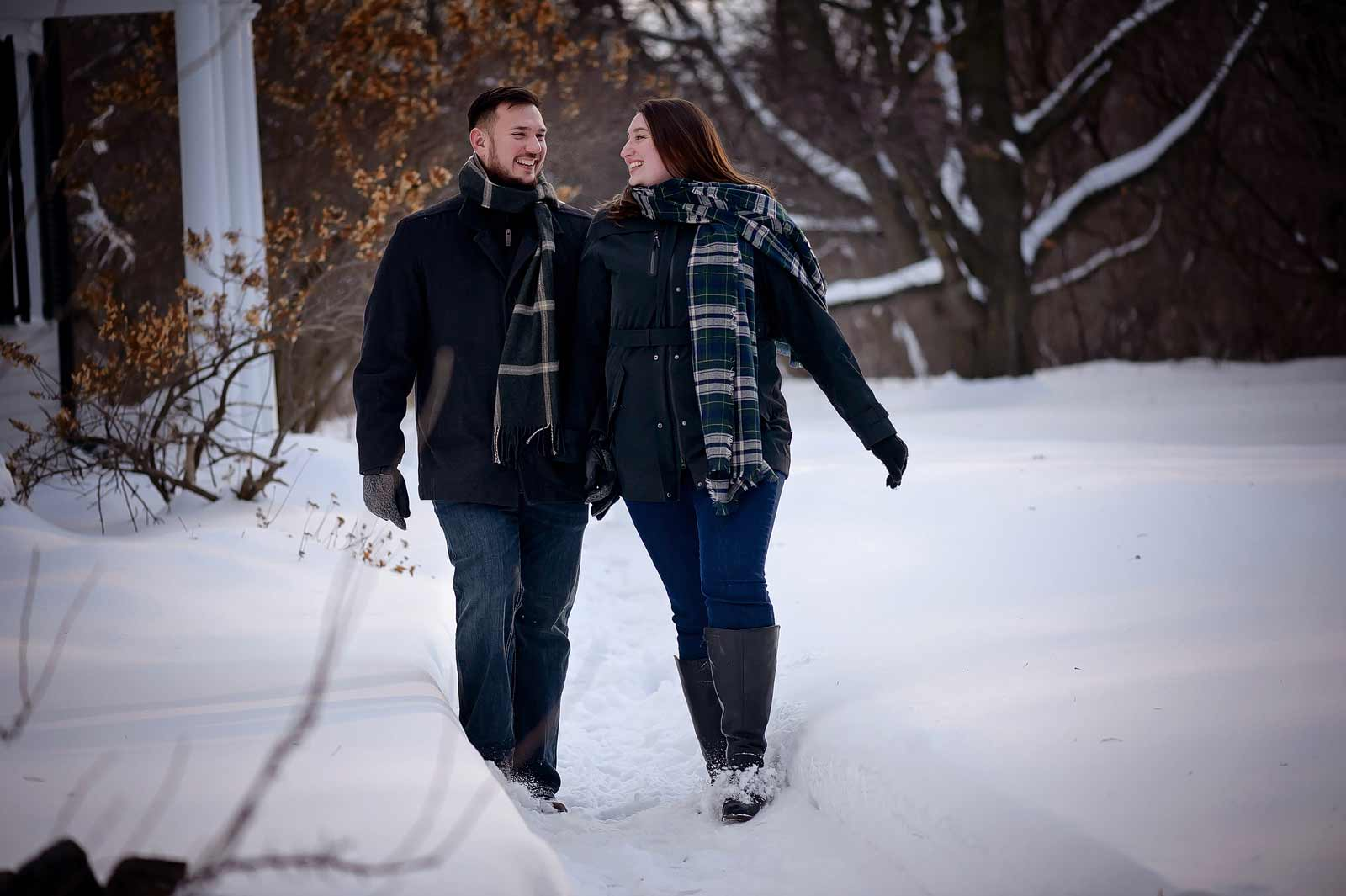 Lauren and Mike's engagement session at Billings Estates in Ottawa walking through the snow in the winter