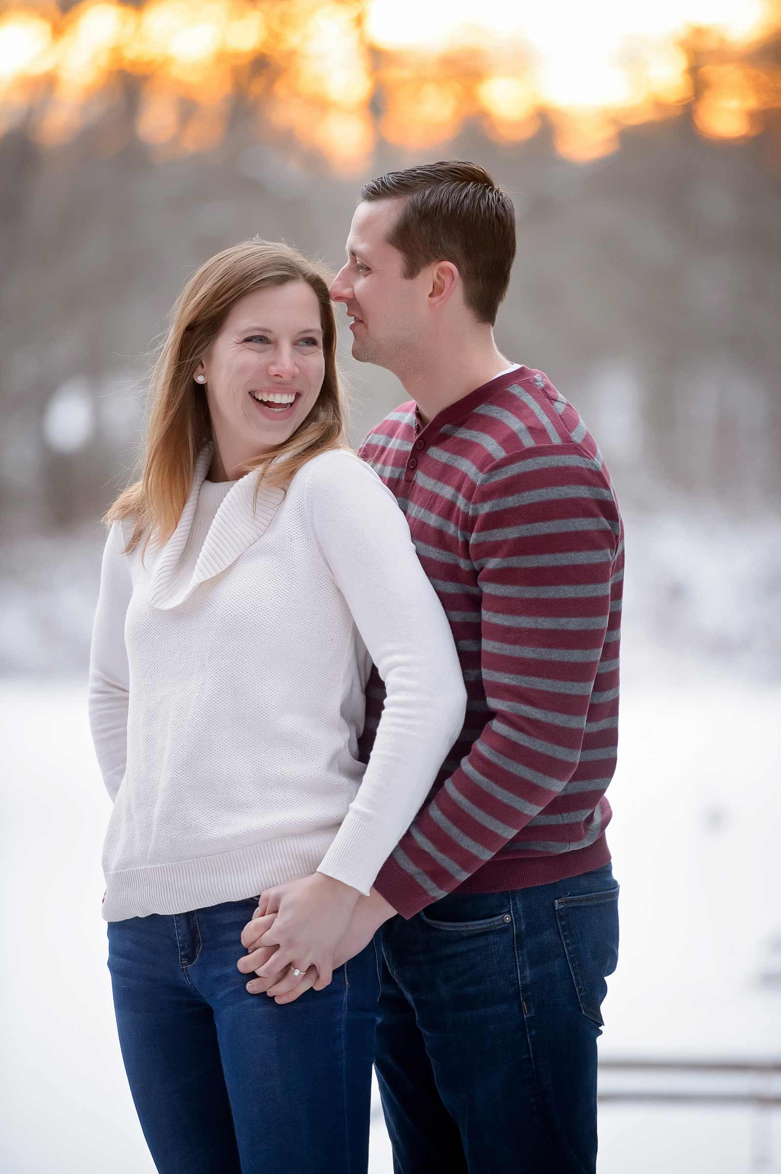 Bridget and Mike's winter engagement session in Manotick, Ottawa, Ontario, standing together in the snow at sunset