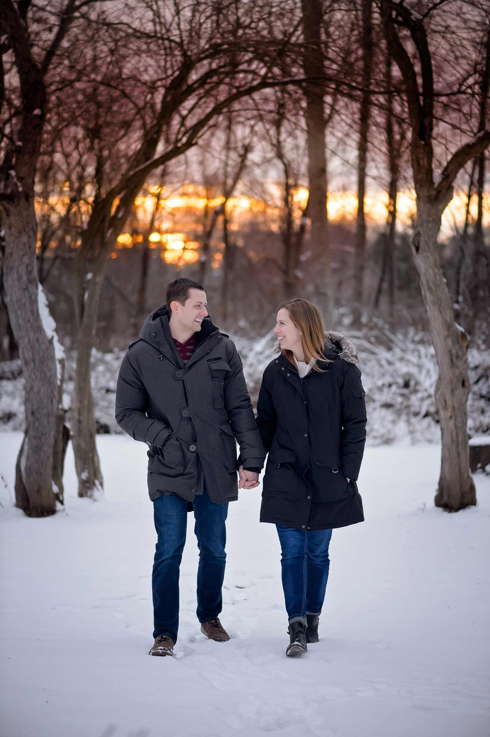 Bridget and Mike's winter engagement session in Manotick, Ottawa, Ontario, walking in the snow