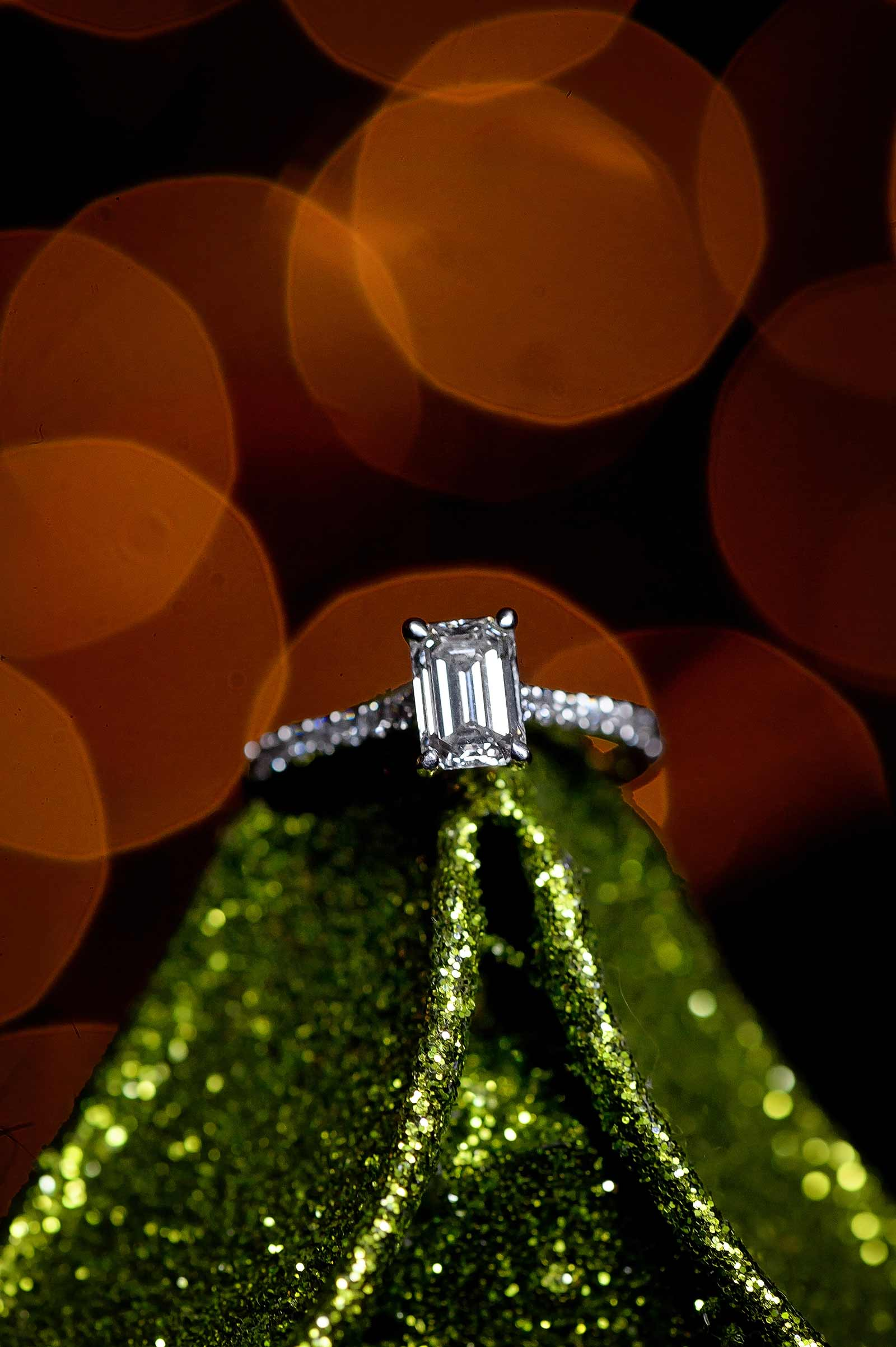 Bridget and Mike's winter engagement session in Manotick, Ottawa, Ontario, engagement ring with Christmas tree in the background