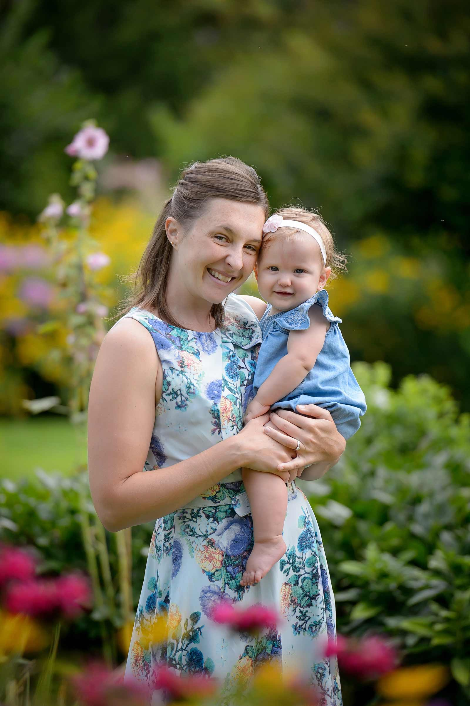Mommy and baby girl at Maplelawn gardens in the summer