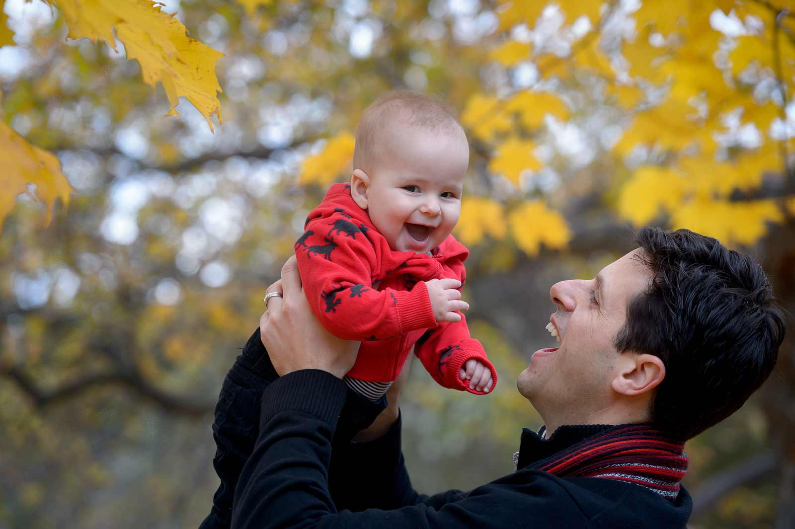 Baby laughing with Daddy with the fall leaves in Westboro, Ottawa