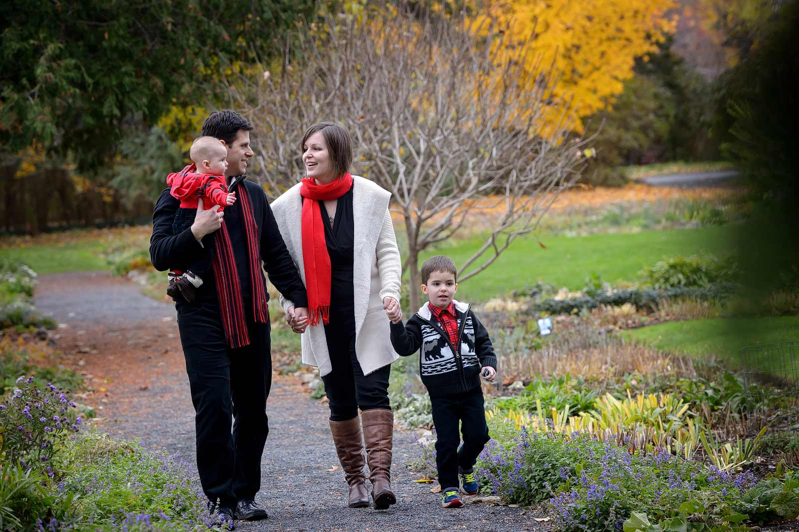 Family walking through the gardens in the fall at Maplelawn in Ottawa