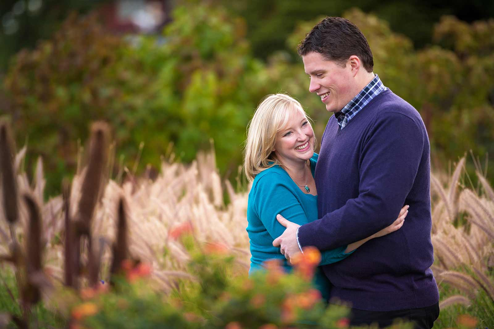 Couple laughing and cuddling in the Ornamental Gardens in Ottawa