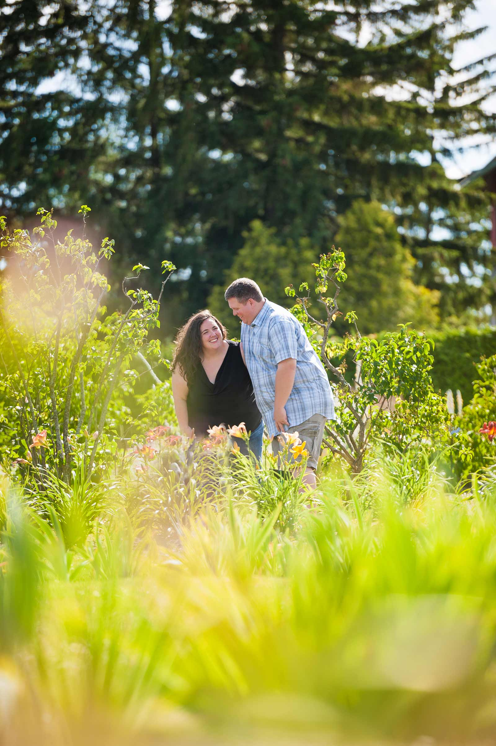 Ottawa couple standing in the flowers at the Ornamental Gardens