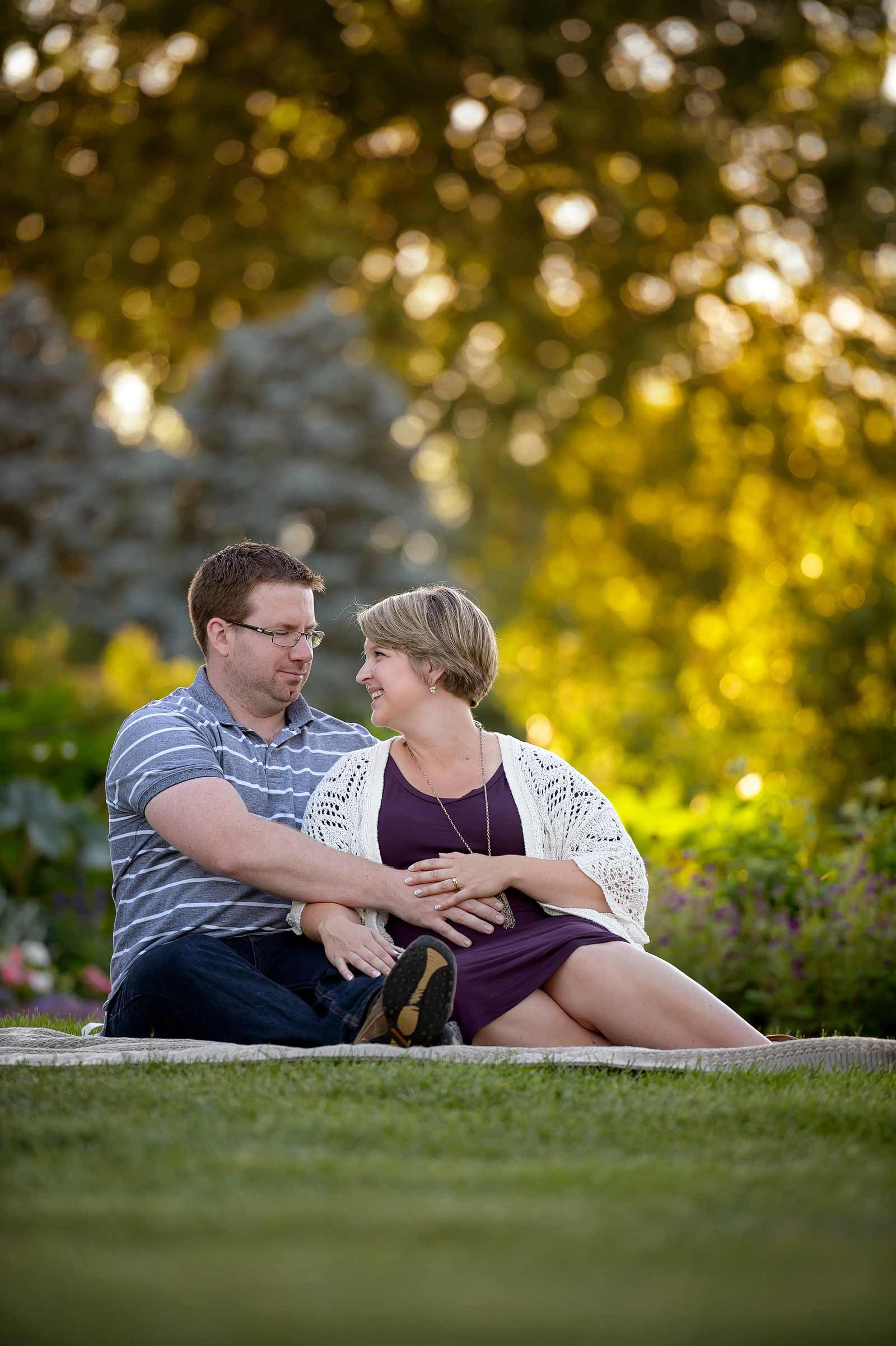 Couple laughing and sitting on a bench in the Ornamental Gardens