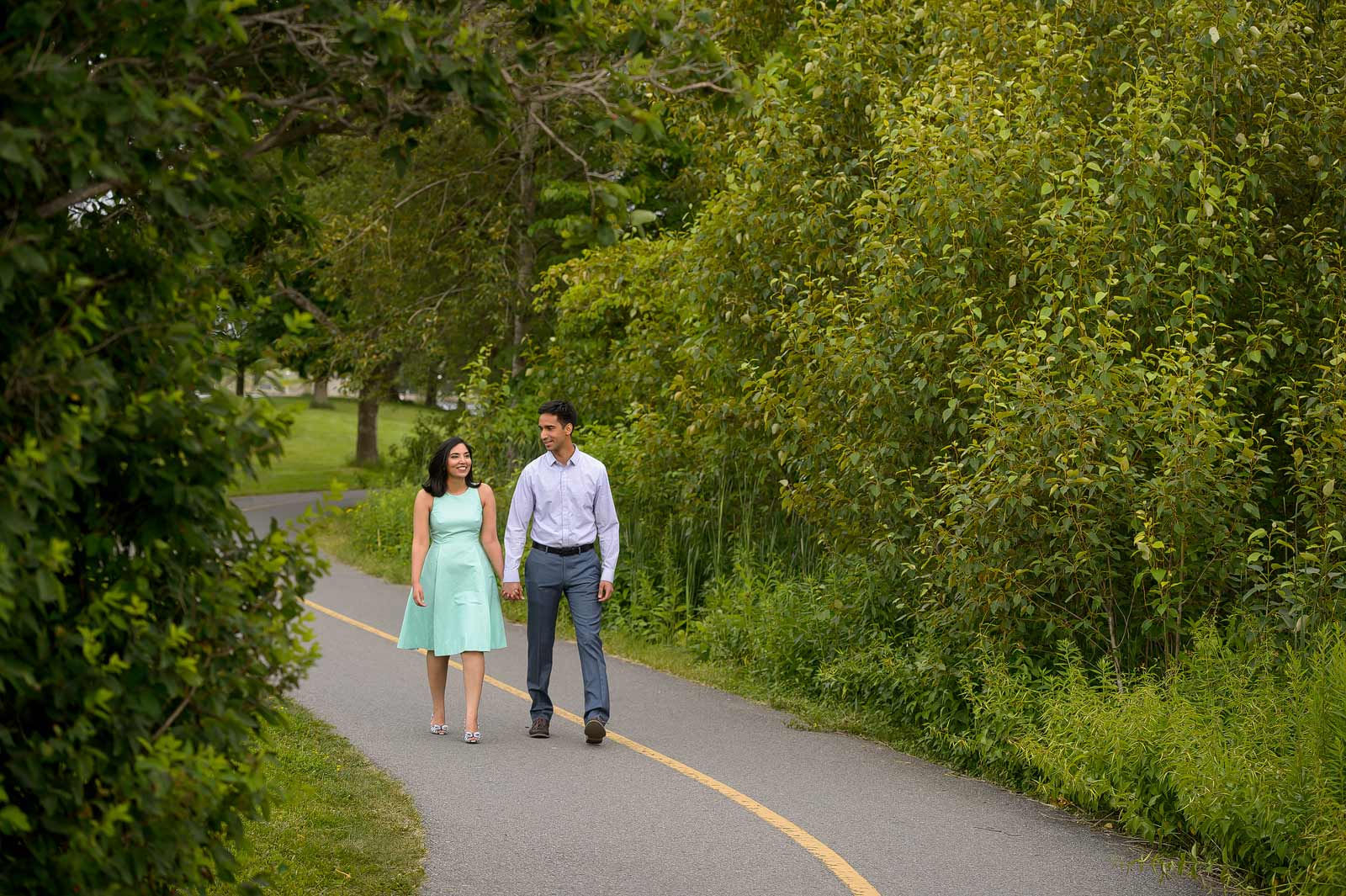 A couple having a romantic stroll along the paths at Dow's Lake