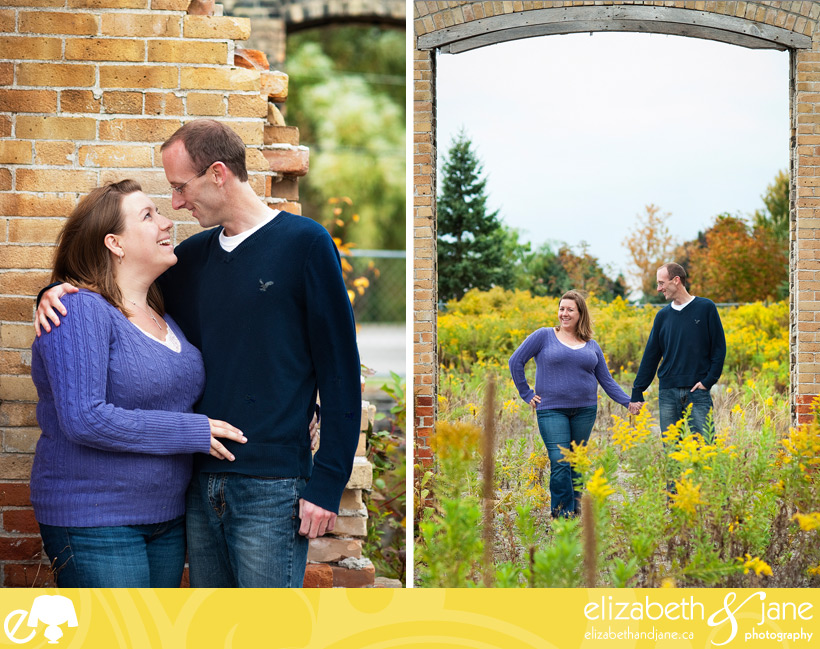 Engagement photo: couple standing in an abandoned building outside