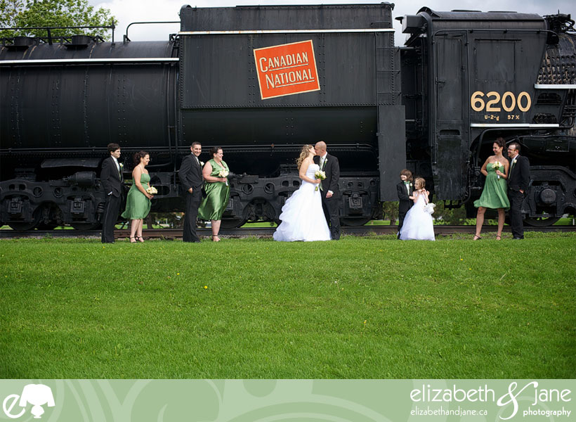 Bridal party in front of an old train