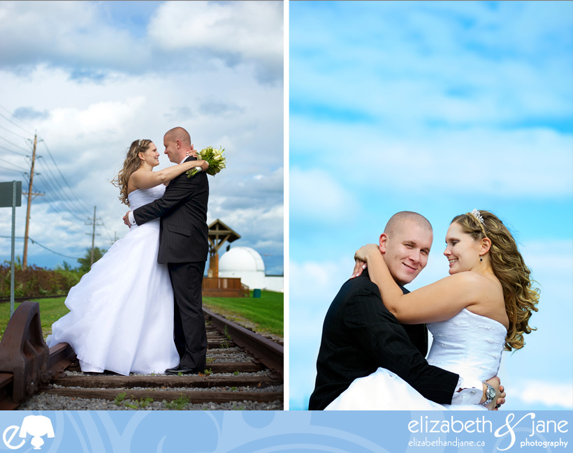 Bride and groom portraits on the train tracks with blue skies